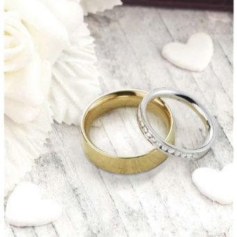 bride and groom wedding bands in white and yellow gold with diamonds