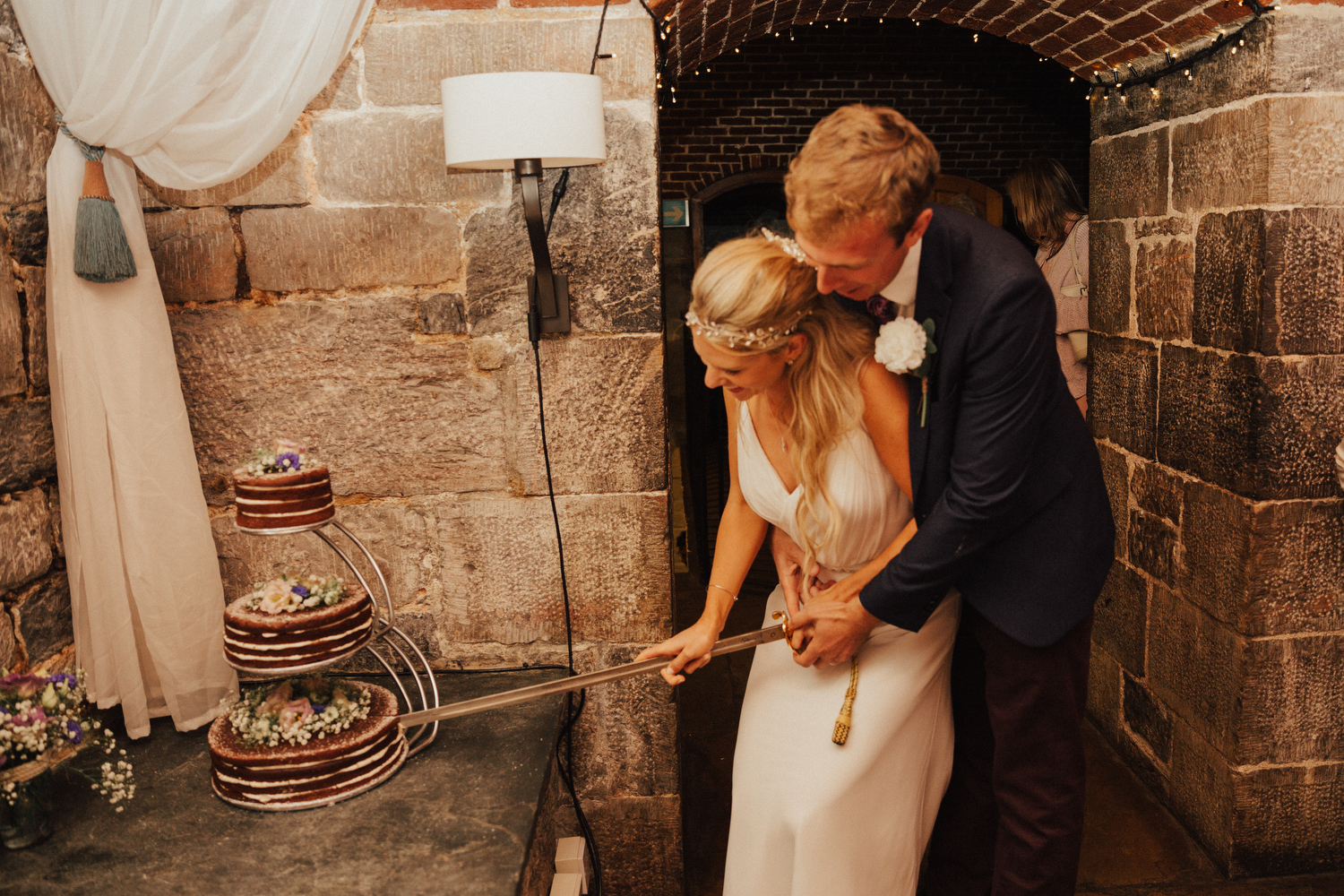 Evening wedding reception at Polhawn Fort in Cornwall