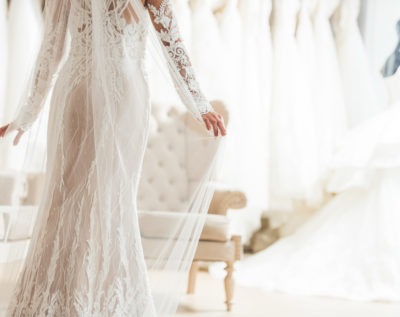 bride in lace dress in wedding dress shop