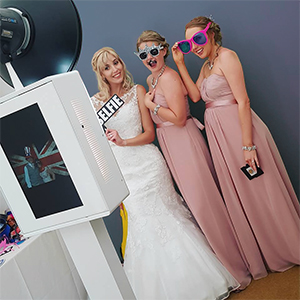 open photo booth for a wedding, bride with her bridesmaids