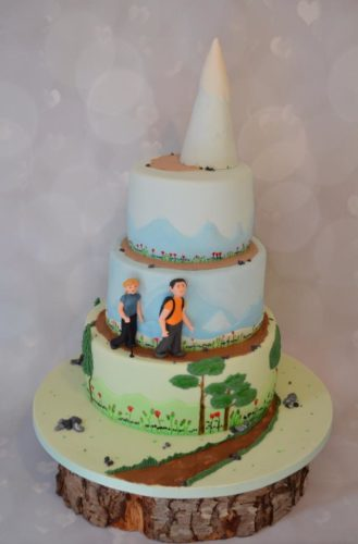 beautiful wedding cake with country scene
