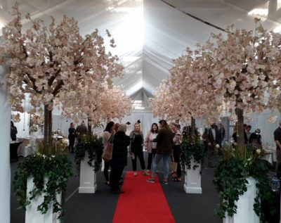 catwalk lined with blossom trees at a wedding fair