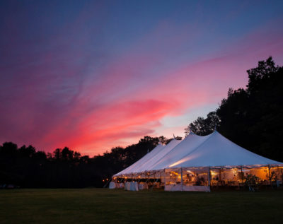 An event wedding marquee at night with a sunset during a wedding