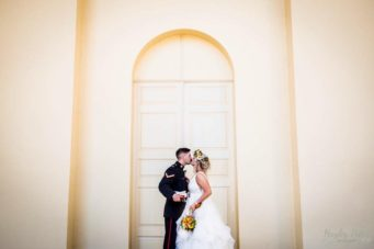 couple standing in front of doors at Kimbolton Castle