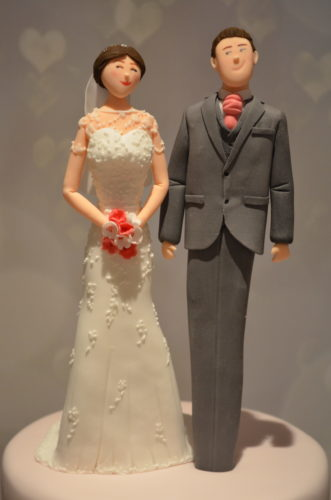 wedding cake topper of the couple