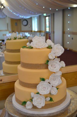 beautiful orange wedding cake with white flowers