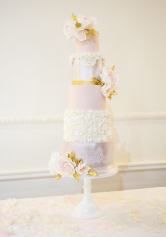 Beautiful pink and ivory 4 tier wedding cake with sugar flowers
