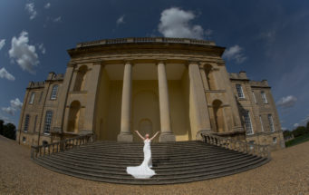 couple standing in front of Portic Steps at Kimbolton Castle