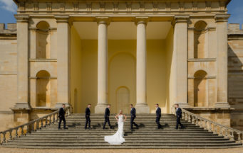 couple standing in front of Portico Steps at Kimbolton Castle