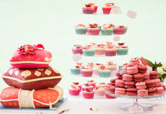 wedding cupcake tower with pink and turquoise cupcakes