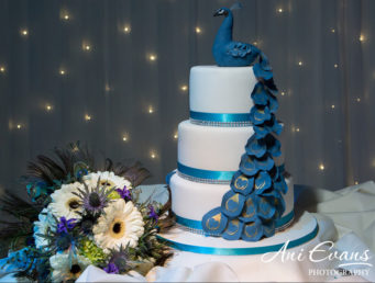 beautiful wedding cake with peacock feathers