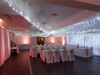 Something Borrowed Event Hire offers wedding venue decor in Northampton, offering everything from chair covers to wall draping.