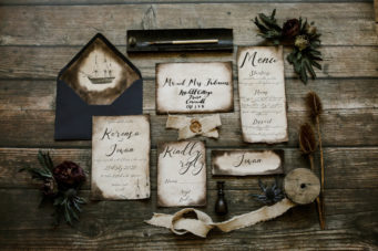 Rustic old wedding stationery set with calligraphy and ribbons