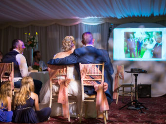 Couple watching a slide show of their wedding day