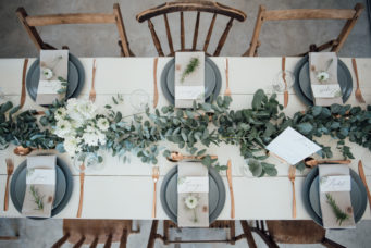 Beautifully set wedding breakfast room at the Camel Studio wedding venue