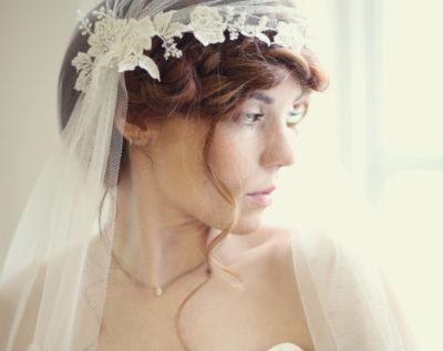 Bride wearing a bespoke headdress and wedding veil