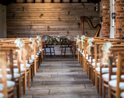 Courtyard Barn at Dodmoor House wedding venue set for a wedding ceremony