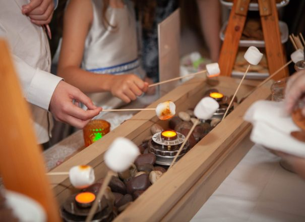Wedding guests enjoying an American style s'mores board