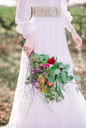 Bride holding her bouquet inspired by the Greatest Showman, photo by Gina Fernandes Photography