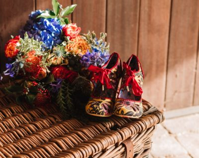 Wedding bouquet and colourful shoes inspired by the Greatest Showman