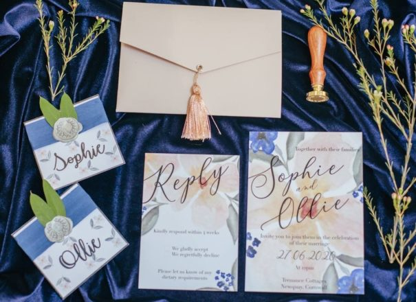 Beautiful custom wedding stationery set with blue and peach florals