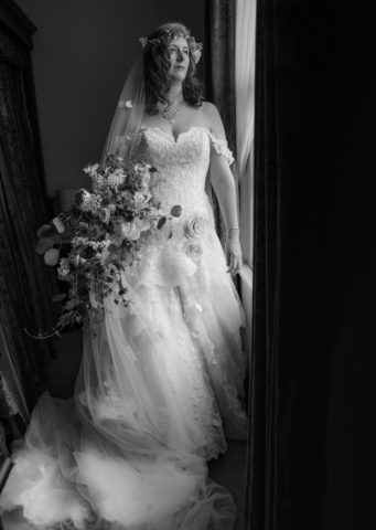 Bride at the window with her bouquet