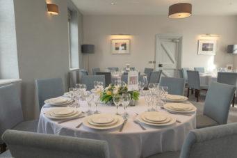 Barracks at Pendennis Castle wedding venue set up for a wedding breakfast