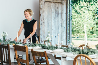 Wedding coordinator at a table in the barn at Camel Studio