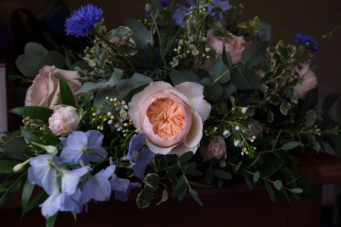 Close up of a bride's bouquet with a beautiful rose
