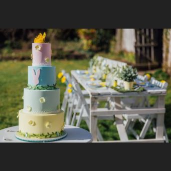 Easter or spring wedding cake with 4 tiers and yellow, green, blue, pink layers