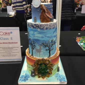 Competition winning wedding cake featuring a woodland scene over 4 tiers