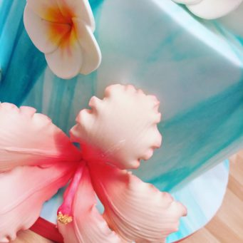 Detail of exotic wedding cake flowers made from sugar with a turquoise marbled cake