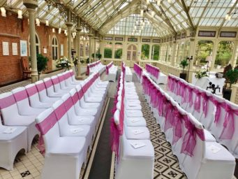 The orangery at Kilworth House Hotel set for a wedding ceremony with pink sashes