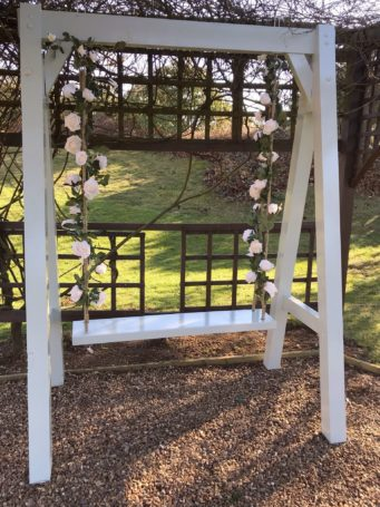 Romantic wooden swing outside Kettering Park Hotel, wedding venue in Northamptonshire