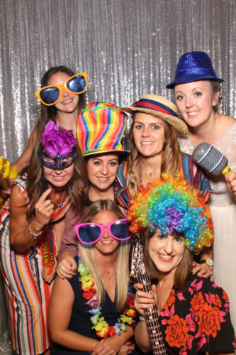 People having lots of fun in a wedding photo booth