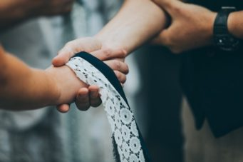 Hand fasting ceremony conducted by a wedding celebrant
