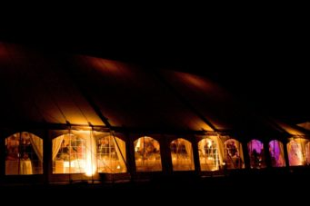 Beautiful wedding marquee lit up in the evening