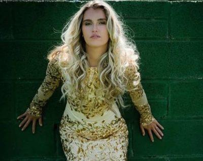 Model wearing a gold glittery wedding dress