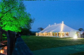Beautiful wedding marquee lit up at twilight