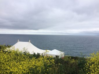Traditional marquee sitting on top of the cliff overlooking the sea