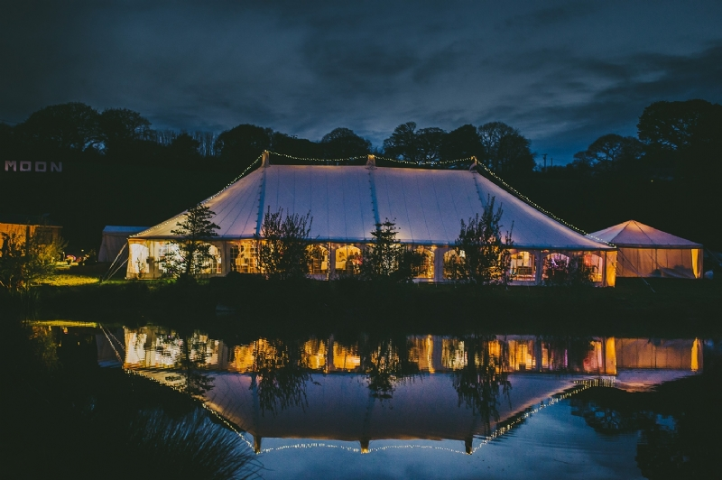 Traditional wedding marquee lit up at night