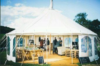 Small traditional marquee set up at a wedding fair at Penganna Manor