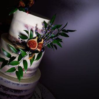 Semi naked wedding cake decorated with a fig