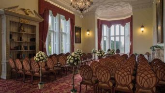 Salvin Longroom at Fawsley Hall set up for a wedding ceremony