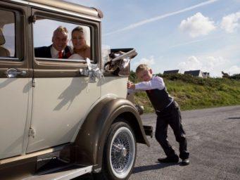 Boy pushing a wedding car!