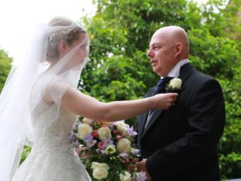 Bride with her father, adjusting his buttonhole