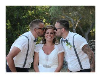 Bride being kissed by groom and best man