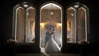 Bride & groom standing outside at night at Fawsley Hall wedding venue