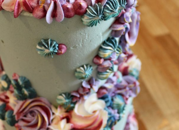 Colourful wedding cake made from buttercream icing