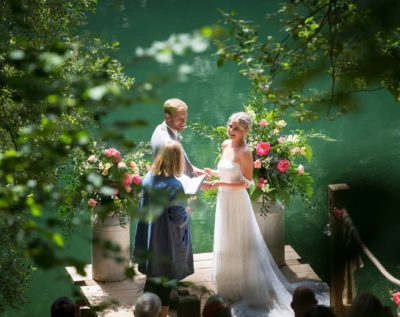 Couple getting married by a Cornish Celebrant in a garden